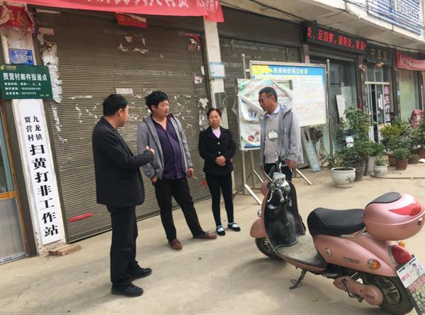 """邓州市城市管理警察大队开展""""进千万家""""与""""扶贫""""活动"""