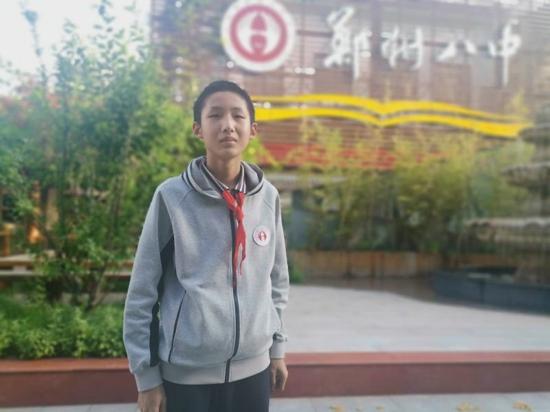 """当战""""疫""""志愿者  郑州14岁初中生身背消杀壶身影最靓"""