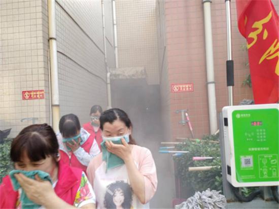 """郑州新同乐社区:""""消防安全培训+演练"""" 筑牢生命防火墙"""