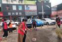 雨中坚守文明创建,周口太康县民政局志愿者热情不减