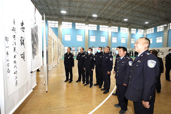 """邓州市公安局:举办""""忠诚颂""""主题书法美术摄影作品展"""