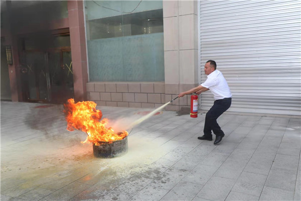 唐河农信联社开展消防安全知识讲座暨消防应急演练活动
